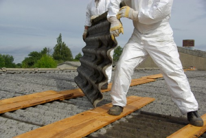 A specially suited professional removes a roof containing asbestos